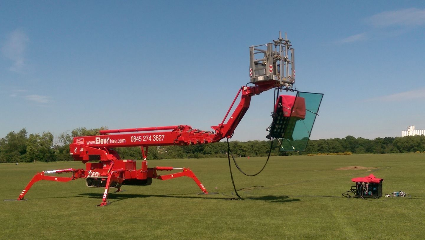 Lighting rig mounted to a tracked access cherry picker