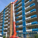 Tracked access cherry picker used for safely cleaning airside balconys